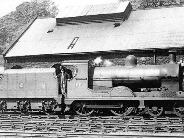 U class No.198 'Lough Swilly' and tender 43 alongside Enniskillen locomotive shed with Driver Jimmy Kelly.
