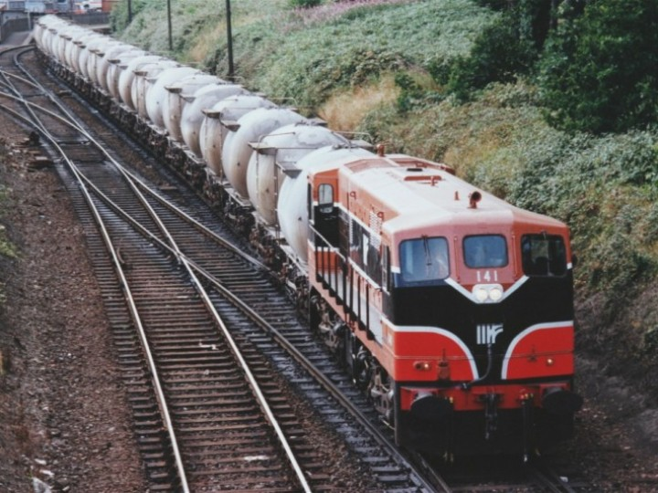In 1994 a freshly painted 141 was captured with this train of cement bubbles at Drogheda. The cutting side to the right of the picture was completely removed when the railcar servicing facility was built in 2004. (B.Pickup)