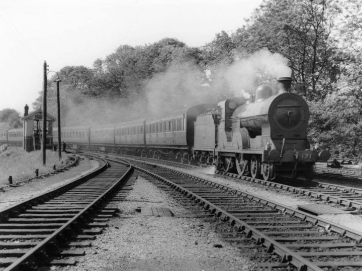 1950s: No.171 and train passing Omagh's North Cabin from the Strabane direction.
