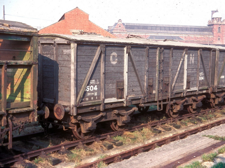 1965: Guinness Vans 504 and 2518 out of use in Maysfields yard. (D. Young)