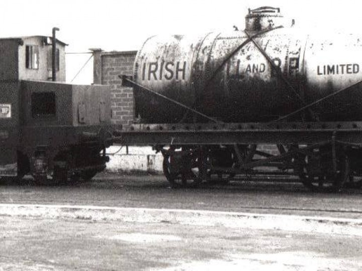No.23 in 1971, awaiting collection by the RPSI from the Irish Shell terminal in Dublin, with a wagon of Class A livery, its silver tank and red lettering indicating it carries a volatile cargo of, say, petroleum. (A.Waldron)