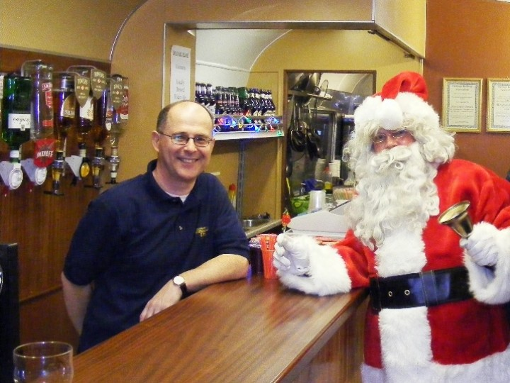 Finally, the bar in action. Santa gets a warm welcome from Paul the barman on 5th December 2009. (C.P.Friel)