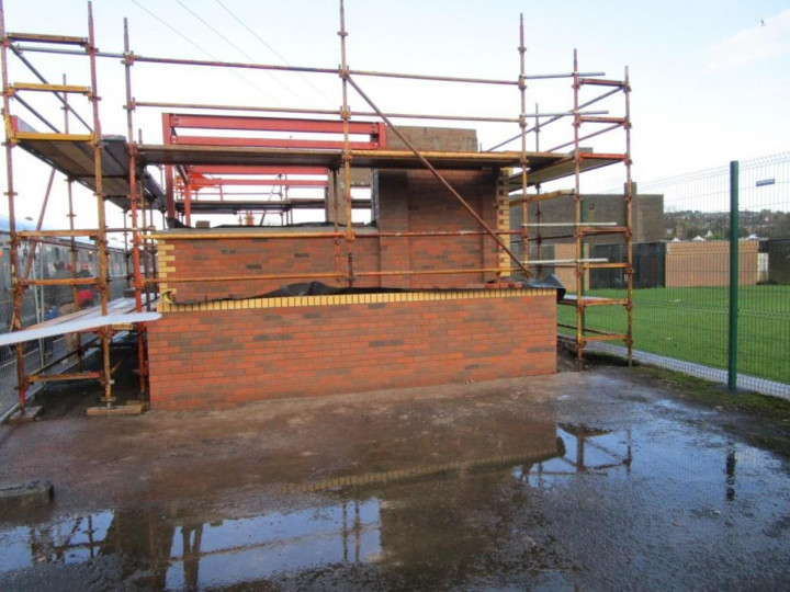 29/11/2015: The signal cabin brickwork matches the station building, seen from the Belfast side.