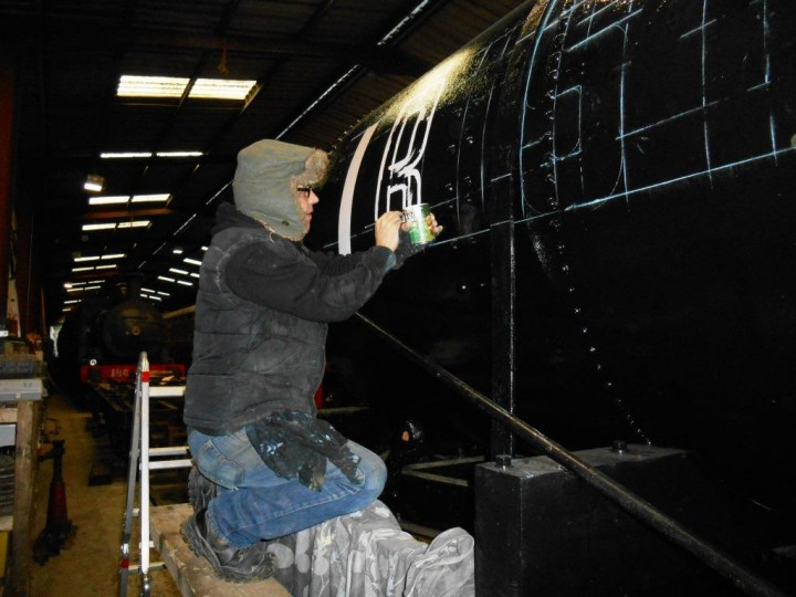 Having carefully marked out guidelines in chalk, John from AirForceOne Artwork begins painting the lettering. (M.Walsh)