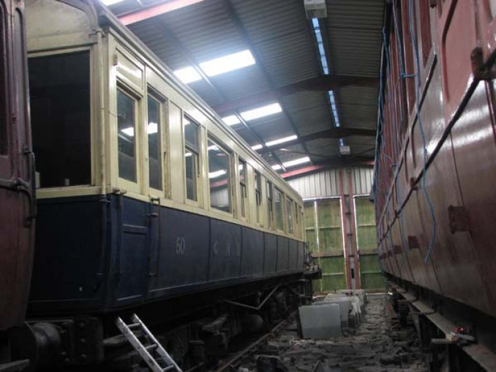 Carriage in blue and cream livery at back of carriage shed latterly before eventual display in the Museum.