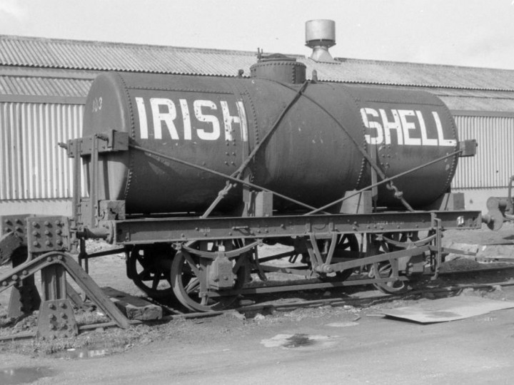 303, a similar wagon to 602, at Belfast's Maysfields goods yards in 1964. This is the Class B livery for wagons carrying less volatile heavy oils such as diesel or bitumen. (D.Coakham)