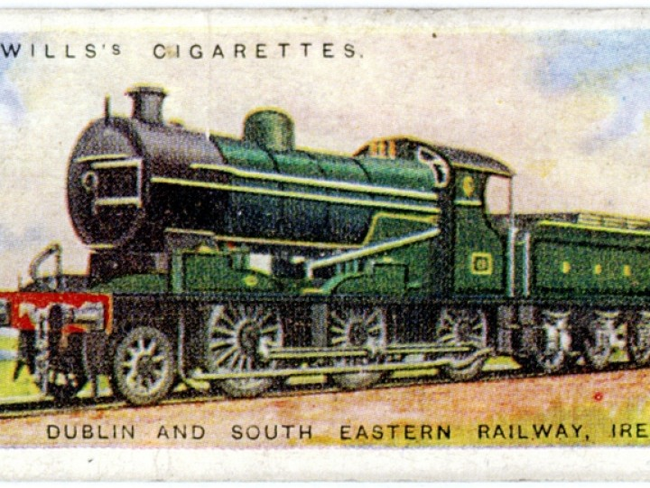 The front and back of the Wills's cigarette card of 1924. Note that the engine is shown with its original boiler - the dome is further forward - and the smokebox is of typically Beyer Peacock style.