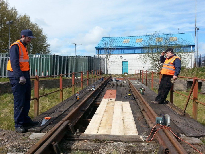 28/4/2016: Matthew and Roy take a break from renewing some of the table timbers. (D. Campbell)