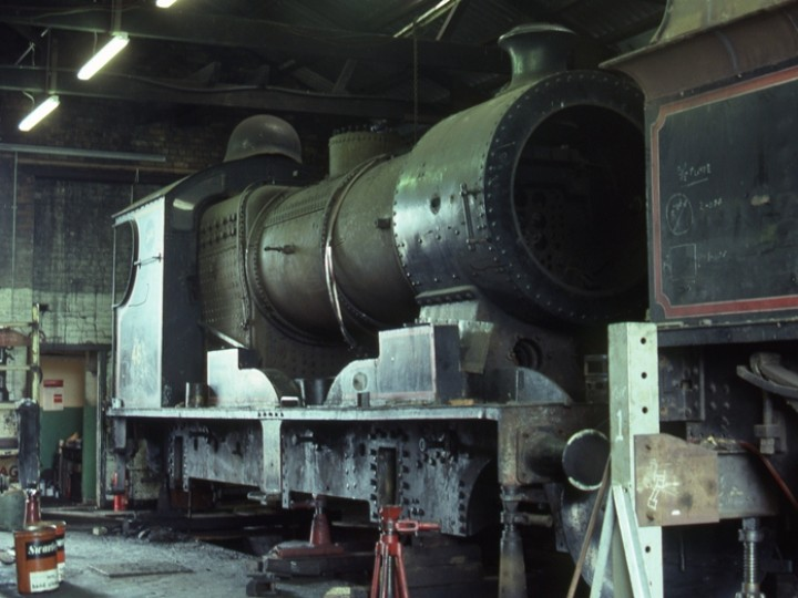 No.461 in the old engine shed at Whitehead during the first of her two lengthy RPSI overhauls. Both engine and tender have been removed from their wheels by labouriously jacking them up. Some of the loco wheels can be seen on the left. (C.P.Friel)