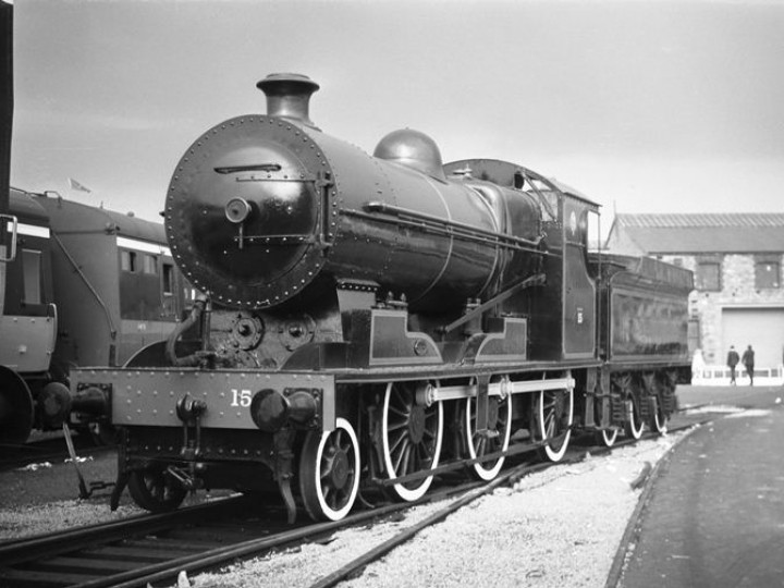 1968: No.461 at Inchicore open day. CIÉ staff have painted her up as DSER 15, in black with red lining. In DSER days she did not have the distinctive Inchicore style smokebox - and the white-wall tyres are a very un-Irish feature apparently added in a fit of creative passion. In the background is GNR(I) No.131. (C.P. Friel)