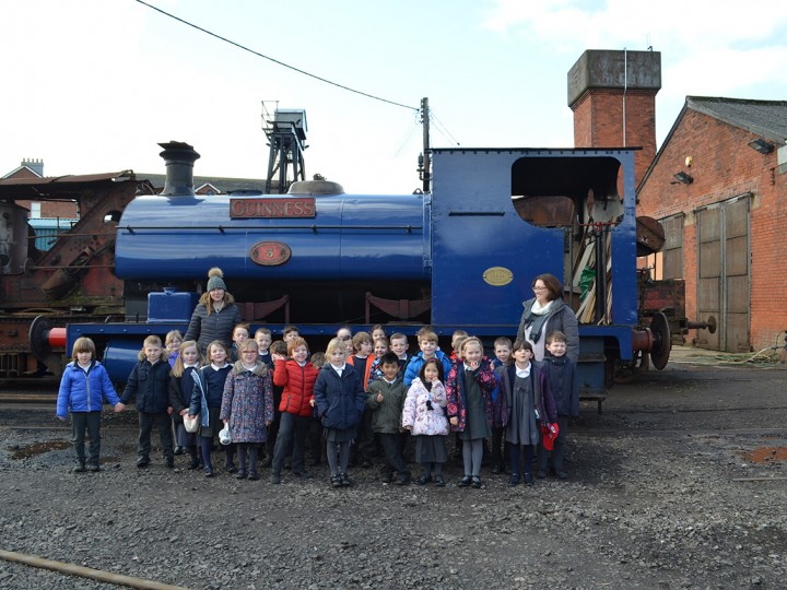 Whitehead Primary School pupils infront of Guinness 3BG at the launch of the Whitehead Railway Museum