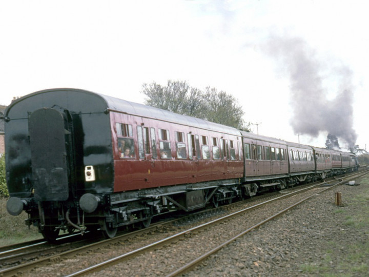 31/3/1997: Now in maroon livery, 9 at Greenisland on rear of the Easter Bunny from Belfast Central to Whitehead. (C.P. Friel)