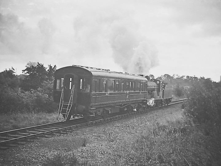 Locomotive No.170 propelling the saloon towards Annaghmore, possibly 1964 pre-closure inspection trip. (RPSI Collection)