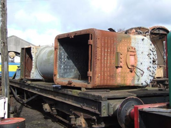 No.131's boiler in store at Whitehead, 2006, with temporary paintwork to keep the rust at bay. Note the flap in the firehole door, a typical feature of GNR(I) main line locomotives. Using the long handle, the fireman would adjust the flap to control the flow of air over the fire. (M.Walsh)