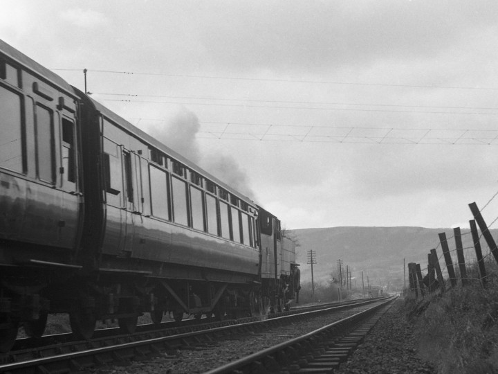 On Easter Tuesday 1970, the Larne line saw the last 'normal' steam passenger trains anywhere in the British Isles. 91 is seen here at the front of one of these trains, the 15:05 service from Carrickfergus to Belfast York Road, starting away from Clipperstown halt. (C.P. Friel)
